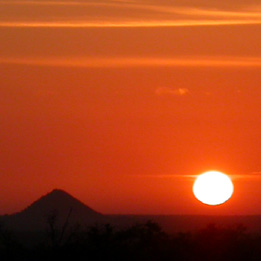 One of the famous sunrises over Masorini mountain watched from Bed in the Bush's verandah.