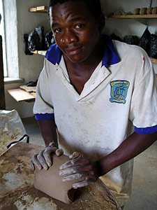 Siphiwe preparing clay.